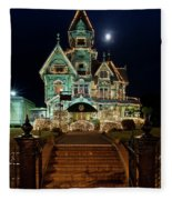 Carson Mansion At Christmas With Moon Fleece Blanket