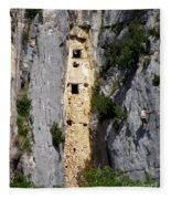 Climber Near Prehistoric Cliff Dwelling Fleece Blanket