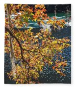 Colorful Fall Leaves Over Blue Water Fleece Blanket