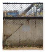 Concrete And Rusty Fence Fleece Blanket