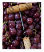 Corkscrew And Wine Cork On Red Grapes Fleece Blanket