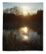 December Sunrise Off Smooth Water Fleece Blanket