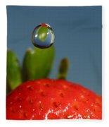 Droplet Falling On A Strawberry Fleece Blanket