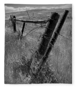 Fence Posts And Barbed Wire At The Edge Of A Field In Montana Fleece Blanket