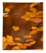 Floating On Orange Fall Leaves Fleece Blanket