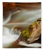 Flowing River Blurred Through Rocks Fleece Blanket