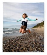 Girl Jumping At Lake Superior Shore Fleece Blanket