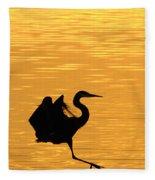 Great Blue Heron Landing In Golden Light Fleece Blanket