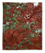 Green Leaves Against Red Leaves Fleece Blanket