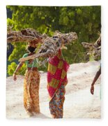 Group Of Women Carrying Firewood Near Fleece Blanket
