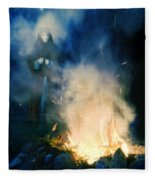 Hooded Figure In A Mask By A Fire Fleece Blanket
