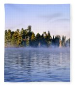 Island In Lake With Morning Fog Fleece Blanket