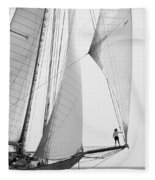 king of the world - a classic sailboat with all sails plying the sea on the island of Menorca Fleece Blanket