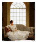 Lady Sitting On Sofa By Window Fleece Blanket