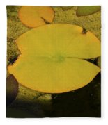 Leaf On A Pond Fleece Blanket