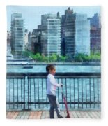 Little Girl On Scooter By Manhattan Skyline Fleece Blanket