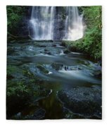 Low Angle View Of A Waterfall Fleece Blanket