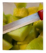 Macro Photo Of Knife Over Bowl Of Cut Musk Melon Fleece Blanket