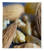 Macro Shots Of Various Dry Fruit Items Such As Almonds And Walnuts And Raisins Fleece Blanket