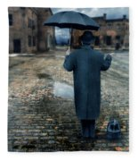Man In Vintage Clothing With Umbrella On Rainy Brick Street Fleece Blanket