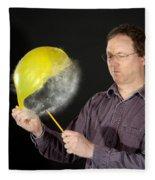 Man Popping A Balloon Fleece Blanket