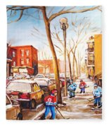 Montreal Street With Six Boys Playing Hockey Fleece Blanket