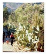 Moroccan People And Cacti Fleece Blanket