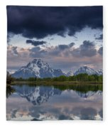 Mount Moran Under Black Cloud Fleece Blanket