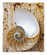 Nautilus Shell On Rusty Table Fleece Blanket