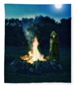 Person Standing By A Bonfire In The Moonlight Fleece Blanket