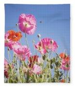 Pink Flowers Against Blue Sky Fleece Blanket