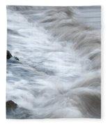 playing with waves 3 - Mediterranean sea foam playing with black stones in cala mesquida - menorca Fleece Blanket