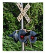 Railroad Crossing Light And Greenery Fleece Blanket