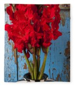 Red Glads Against Blue Wall Fleece Blanket