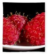 Red Raspberries On A White Spoon Against Black No.0102 Fleece Blanket