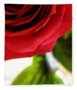 Red Rose In Glass Vase Fleece Blanket