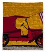 Red Truck Against Yellow Wall Fleece Blanket