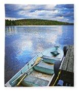 Rowboat Docked On Lake Fleece Blanket