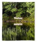 Rowboat Moored On The Bank Of A Lake Fleece Blanket