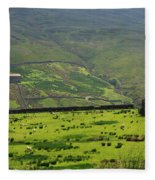 Sheep Graze In A Pasture In Swaledale Fleece Blanket