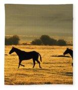 Silhouetted Horses Running Fleece Blanket