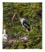 Storks Around A Nest Fleece Blanket