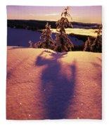 Sun Casting Shadows On Snow Covered Fleece Blanket
