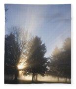 Sunray Through Trees And Fog Fleece Blanket