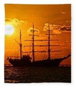 Tall Ship At Sunset Fleece Blanket