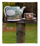 Teapot And Tea Cup On Old Post Fleece Blanket
