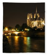 The Seine And Notre Dame At Night Fleece Blanket