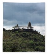 The Structure Of An Abandoned Temple On The Top Of A Green Covered Hill With Blue And White Clouds I Fleece Blanket