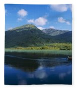 Three People On A Boat In The Lake Fleece Blanket