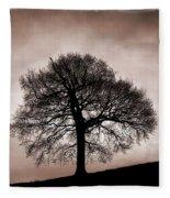 Tree Against A Stormy Sky Fleece Blanket